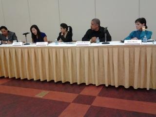 Summit Panel Presenters Addressing Audience